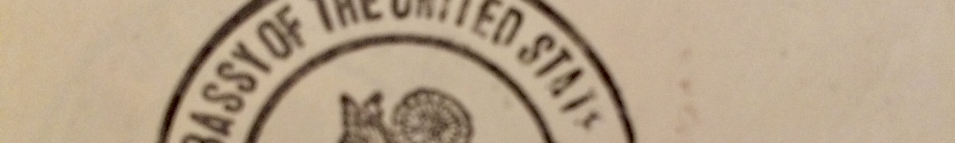 """Part of the official seal. Letters at least partially visible say """"assy of the United States"""""""