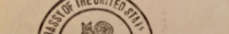 "Part of the official seal. Letters at least partially visible say ""assy of the United States"""